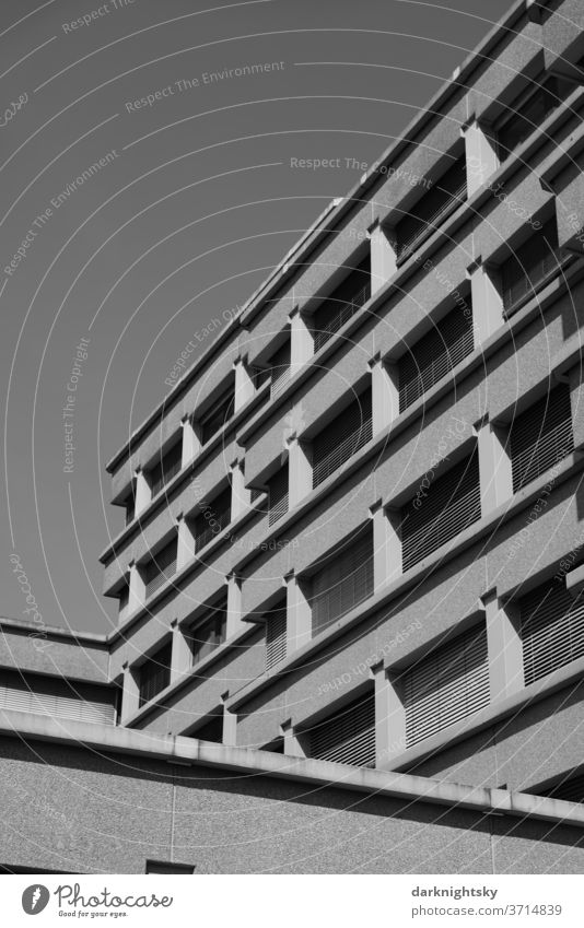 Concrete architecture in black and white Architecture built office brutalism Planning Build Redevelop Facade Window Grid