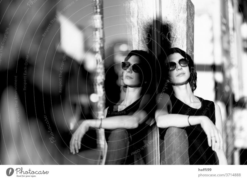 the young woman enjoys the morning sun in a relaxed manner Young woman portrait brunette Looking into the camera 1 Sunglasses pretty Beauty Photography