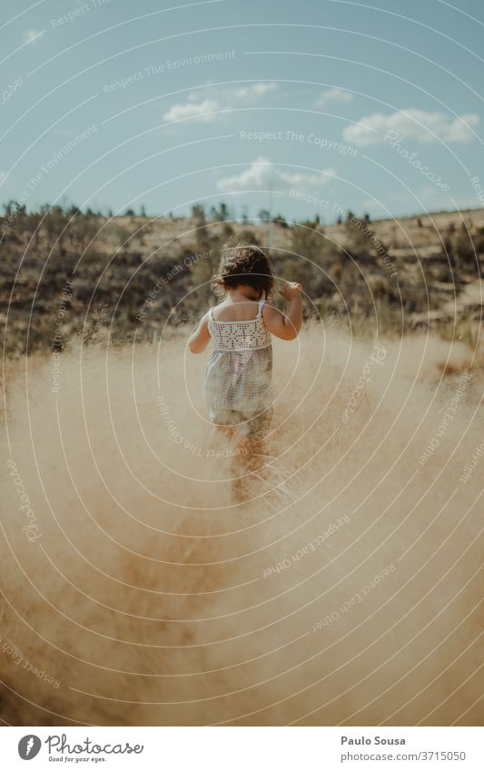 Rear view child playing in the fields Summer Summer vacation Travel photography travel Child childhood Children's game Nature Leisure and hobbies Exterior shot