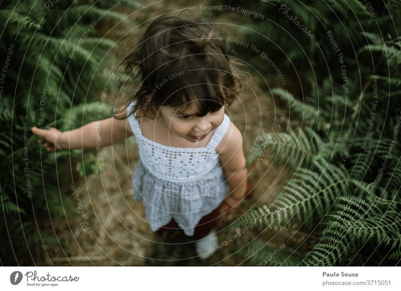 Child on a field of fern Children's game Toddler Nature Fern 1 - 3 years Colour photo Infancy Human being Playing Exterior shot Leisure and hobbies Happy