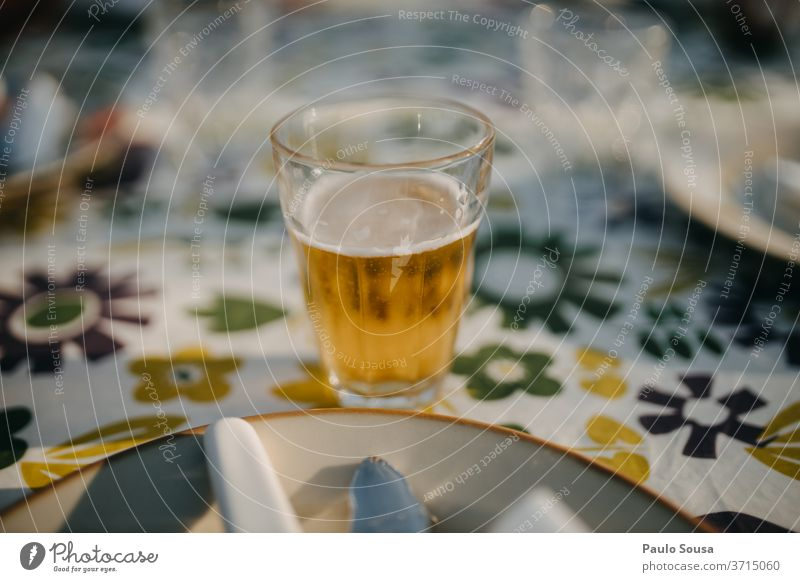 Glass of beer on a table Beer Cold drink Gastronomy Deserted Delicious Exterior shot Beer garden Day Beer glass Colour photo Beverage Drinking Alcoholic drinks