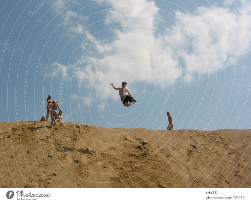 Human being Sky Sun Summer Vacation & Travel Clouds Jump Sand Tall Level
