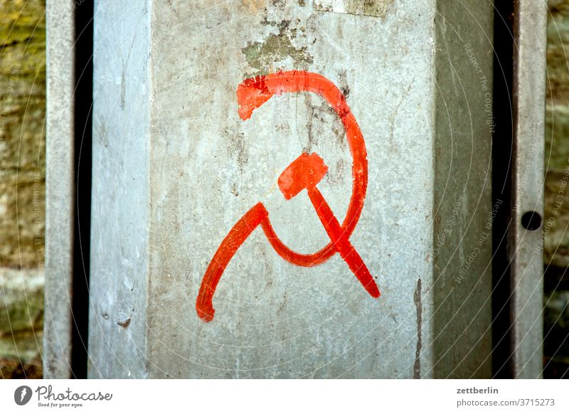 Call for revolution with hammer and sickle Old Revolution Construction site symbol world revolution proletariat Hammer Old town Ancient Architecture
