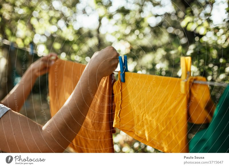 Woman hanging clothes on clothesline Clothing Clothesline Hanging Dry Laundry washed Clean Holder Housekeeping Rope Household Exterior shot Washing day White