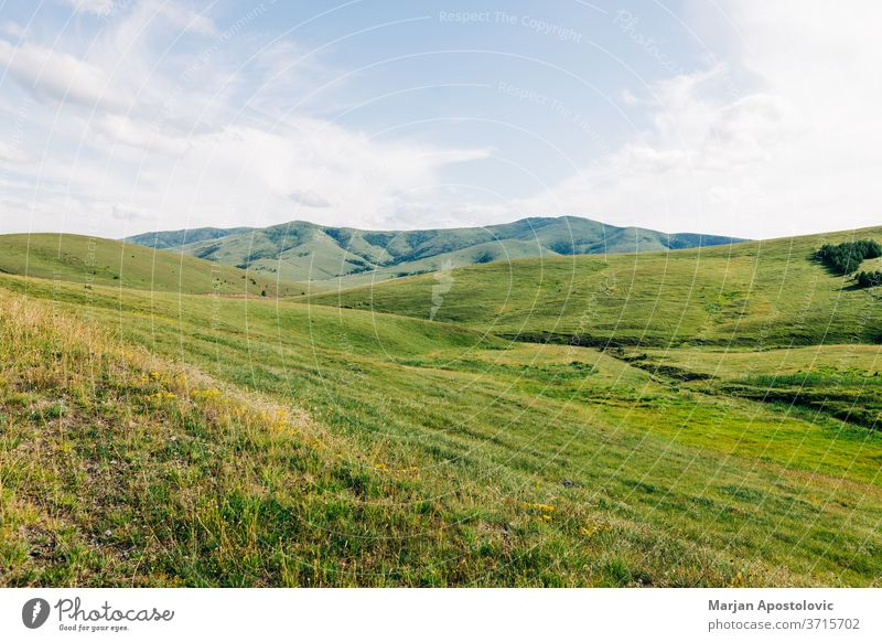 Beautiful hillside landscape in the mountains adventure background beautiful clouds country countryside environment europe explore farmland field freedom grass