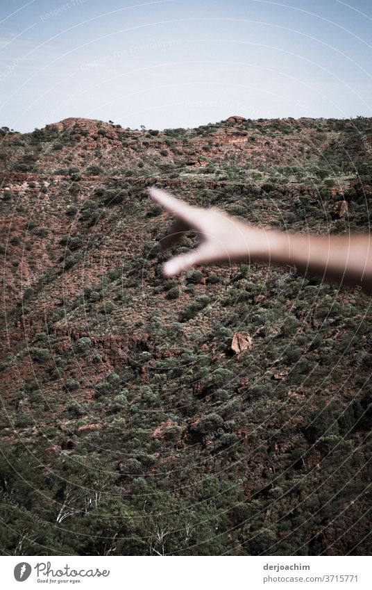 over there, the outstretched hand points to something. In the background rocky slope stop hand Colour photo Together Human being Exterior shot Trust Day