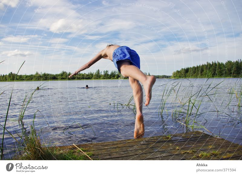 Young man jumps into a lake, summer frog's perspective Swimming & Bathing Freedom Summer Sun Human being Life Nature Elements Water Sky Clouds Sunlight