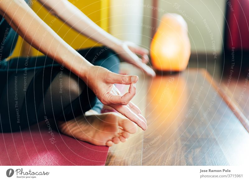 detail of woman's hands in relaxation yoga position health contemplation harmonious exercise comfort class breathing sitting pretty indoors practice prayer