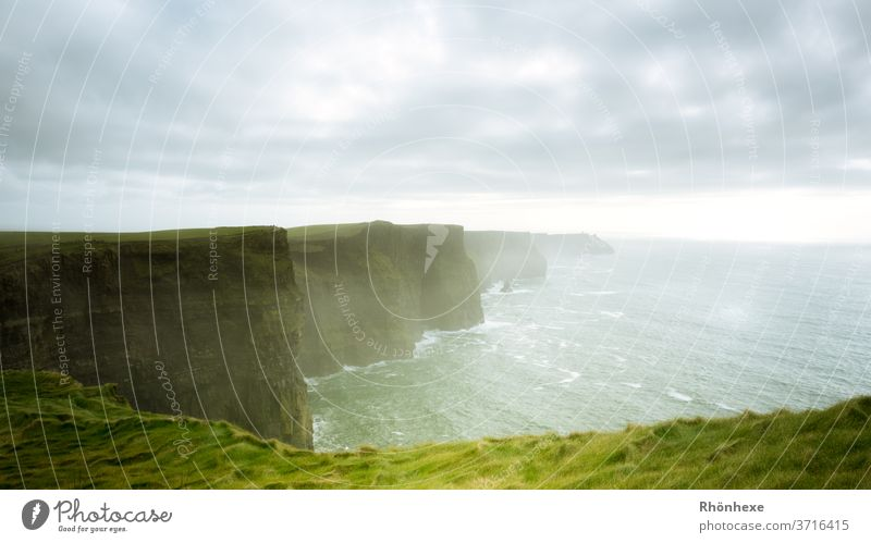 Fascinating cliffs, the Cliffs of Moher, on the west coast of Ireland West Coast roughcast Colour photo Exterior shot Nature Rock Vacation & Travel Tourism