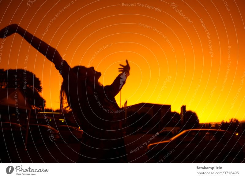 Silhouette of a woman stretching her arms into the red-yellow sky Happy Optimism Joy Happiness Movement Contentment Enthusiasm Emotions Joie de vivre (Vitality)