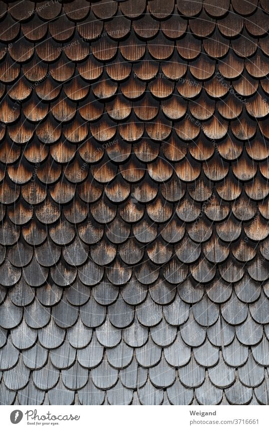 Wooden shingles on old farmhouse House (Residential Structure) wood Facade Weather Brown Weathered Gray allgau Rain Skin Flake wooden shingles