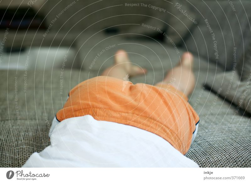 Human being Youth (Young adults) Vacation & Travel Relaxation Calm Life Emotions Boy (child) Legs Moody Lie Orange Body Leisure and hobbies Infancy Back