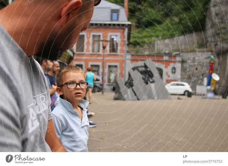 Boy wearing glasses having a conversation with his father Boy (child) Parents Parenting Child Infancy Adults Family & Relations Son Portrait photograph Together