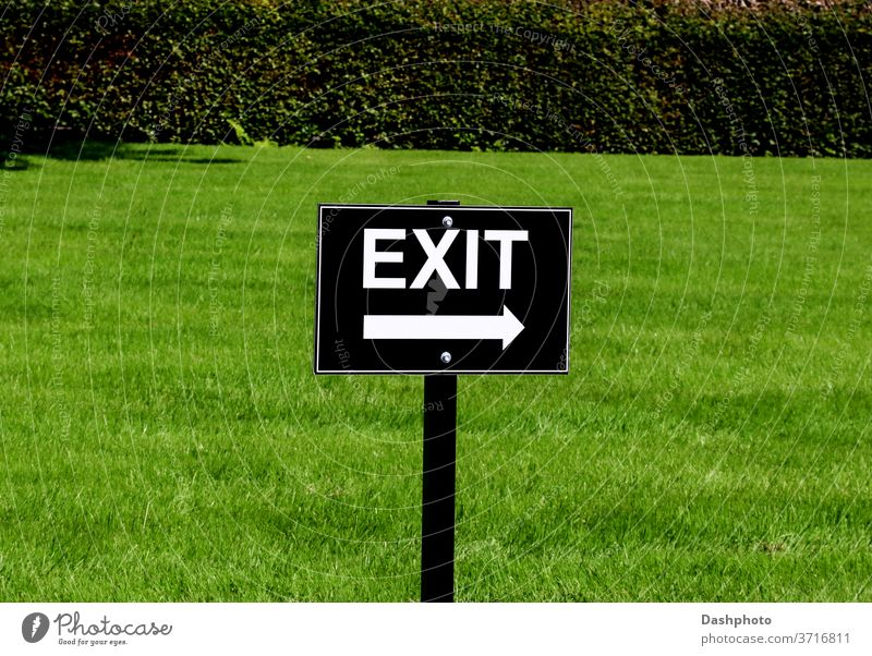 Black and White Exit Sign at a Country Estate Car Park attraction event gathering sign signboard signpost exit arrow black white lettering writing printing