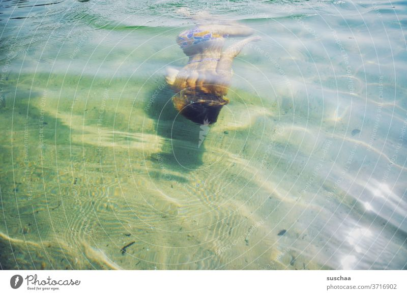 young people diving in shallow seawater Child girl Youth (Young adults) teenager Water Lake Swimming lake Summer Refreshment refreshingly Dive bathe be afloat