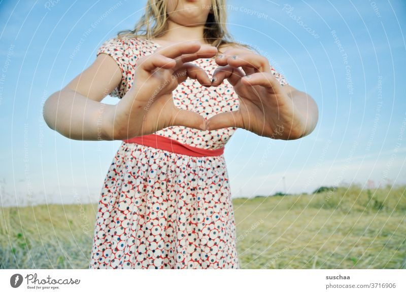 girl holds a heart out of her hands Child Dress Summer Summery Fingers Heart heartfelt formed dear Love by hand Emotions Infancy Declaration of love With love
