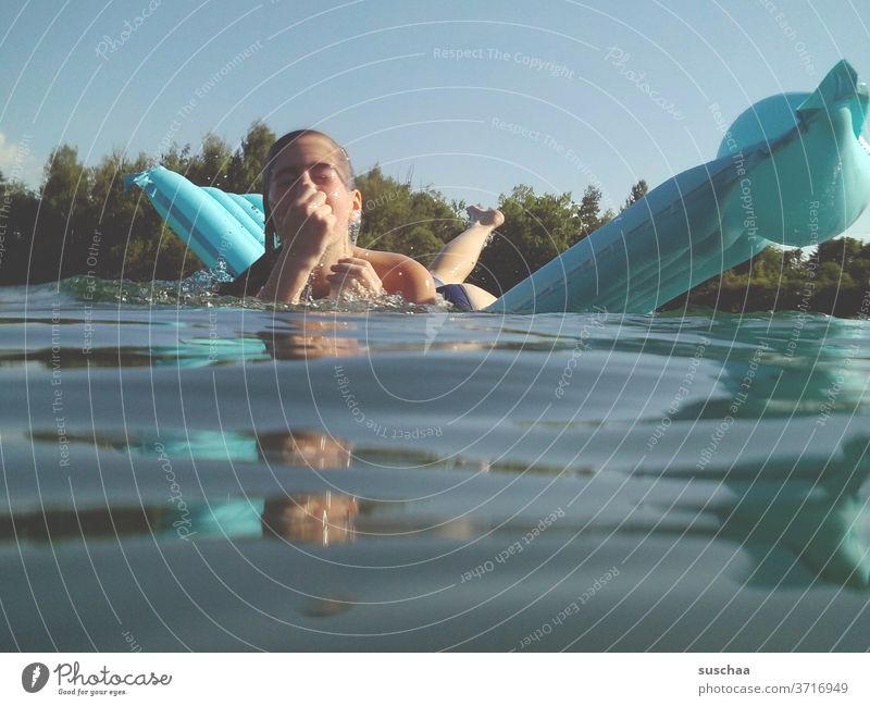 girls on a blue air mattress on a hot summer day at the lake just before diving down Child Lake Swimming lake Water Air mattress be afloat Swimming & Bathing