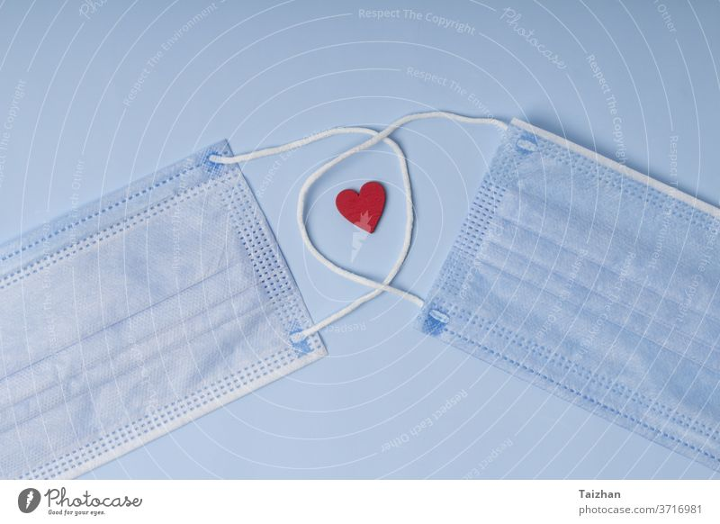 sanitary mask with red heart .  Pandemic insurance, airborne diseases. Concept care and treatment with love breathing corona coronavirus doctor emotional