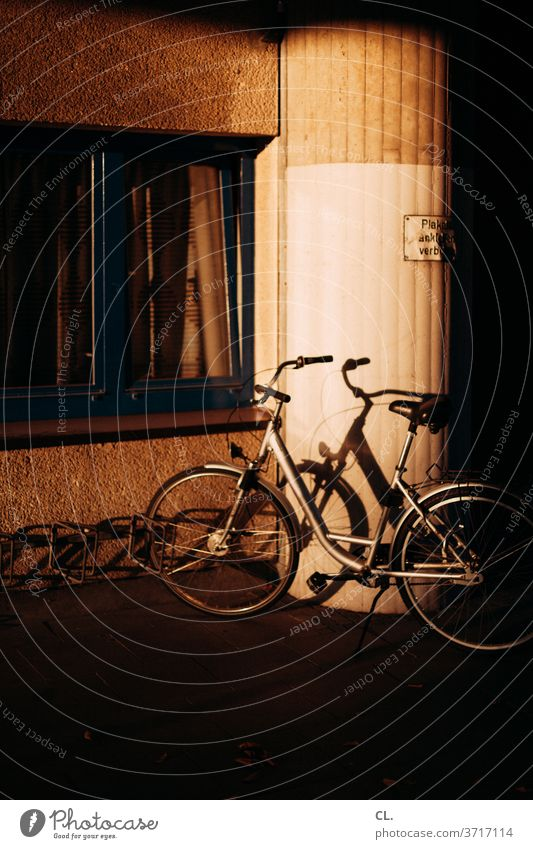a bicycle Bicycle Wheel conceit Sunlight Esthetic Means of transport Shadow Light Day standstill Parking Parking lot Exterior shot Colour photo Deserted