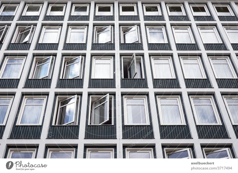 hotel building with many rows of windows hostel multistory dormitory exterior facade modern urban housing residential apartment block complex student hall