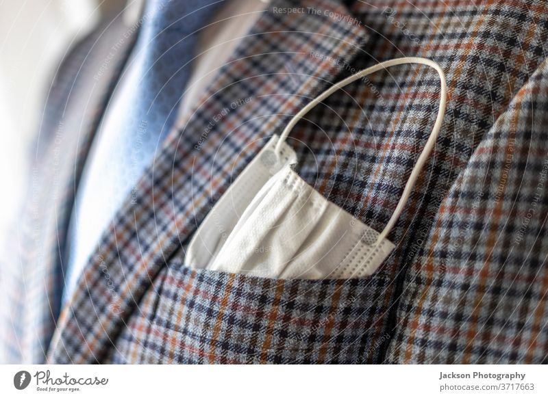 Elegant man with protective mask as handkerchief in chest pocket. corona jacket suit health care covid-19 covid 19 pandemic corona virus elegant businessman