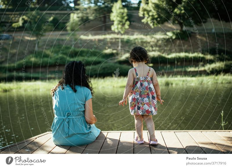 Mother and daughter looking at river Mother with child motherhood Daughter Child childhood Together Happiness Woman care people Love Parents Family & Relations