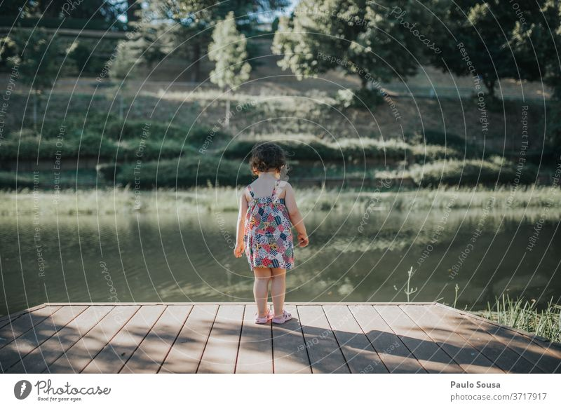 Rear view child watching river River riverside Child Exterior shot water Vacation & Travel Nature Environment Sky Summer Tourism Forest Summer vacation
