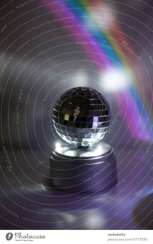 disco ball in front of rainbow light Light Reflection Feasts & Celebrations Party Disco ball Reflection & Reflection Rainbow