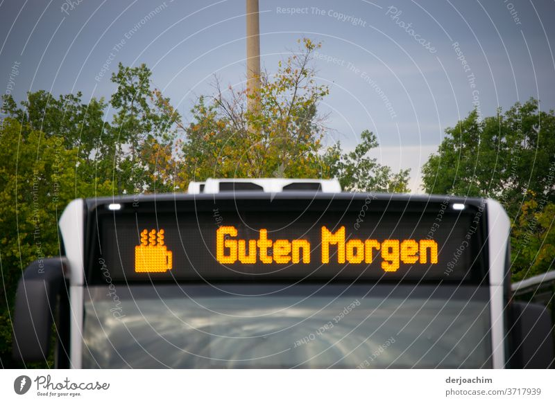 GUTEN MORGEN ..with coffee is standing on a bus with the graphic of a cup of coffee. Bus Transport Station Street Means of transport Exterior shot Colour photo