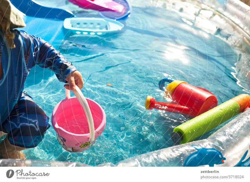 Little child in the small swimming pool pool swinningpool Basin Water Water basin Paddling pool bathe Summer midsummer ardor game Toys water toys Bucket