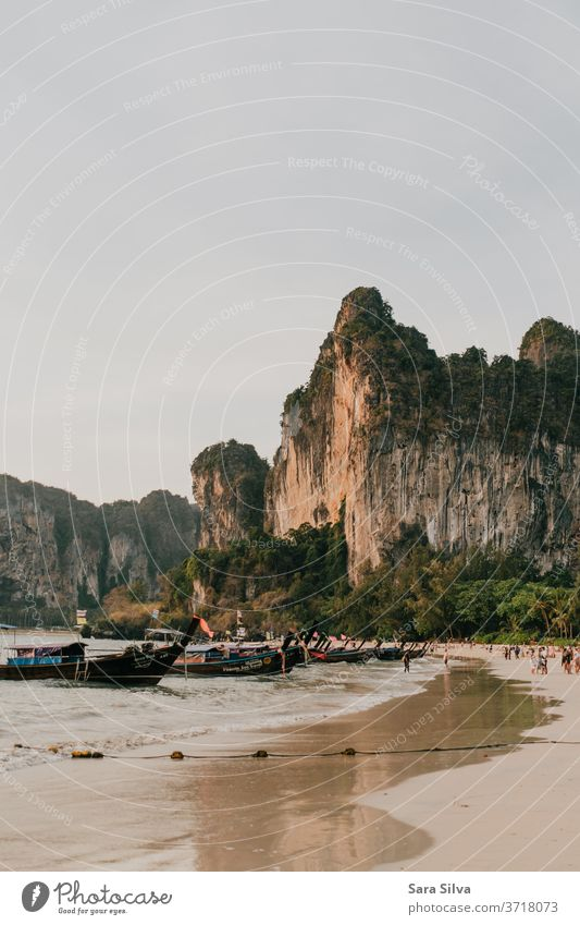 Railay Beach Sunset golden hour long tail boats thailand railay