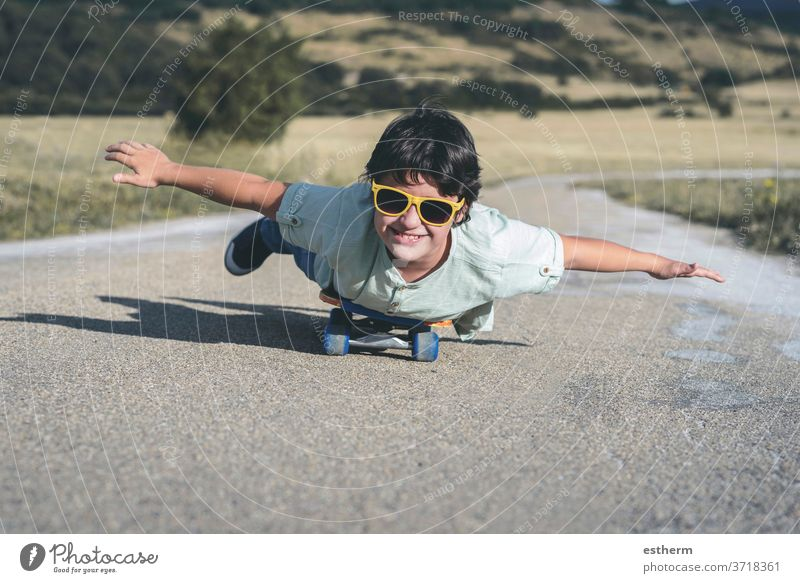 happy kid with skateboard and sunglasses on the road sport child travel childhood skater happiness skating activity lifestyle active city leisure urban smile