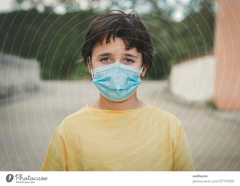 Close-up of kid wearing medical mask coronavirus epidemic pandemic quarantine child covid-19 symptom medicine health positive test hospital city gesture casual