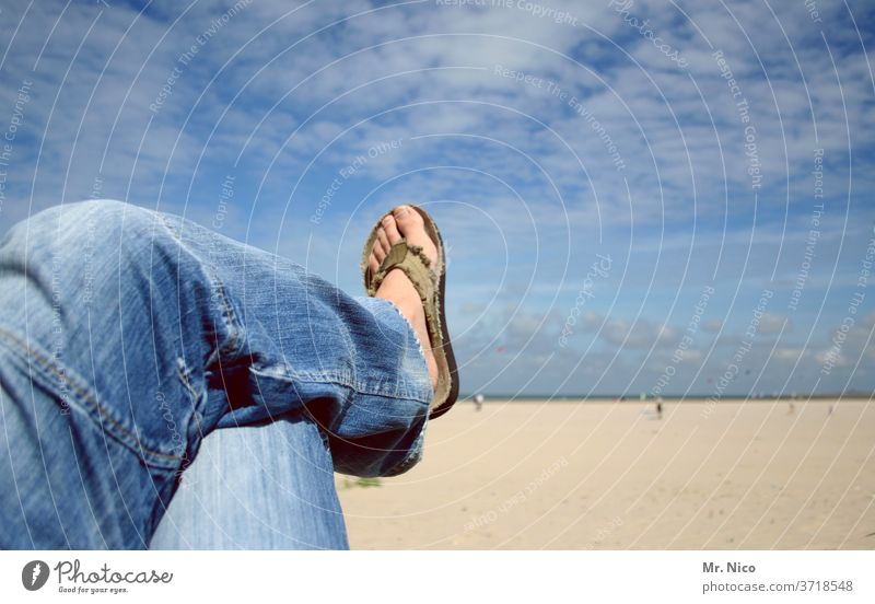Hanging on the beach Beach Blue sky Clouds Jeans blue jeans Flip-flops Easygoing Relaxation Clothing Fashion Material Denim Lie feet Legs Lake Ocean Summer