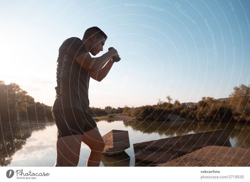 man training next to river male athletic sport jogger bridge healthy workout outdoor lifestyle active athlete sky sporty runner working men fitness exercise