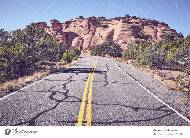 Scenic road in Colorado National Monument Park, USA. trip travel summer filtered asphalt highway marking lanes park adventure journey road trip landscape nature