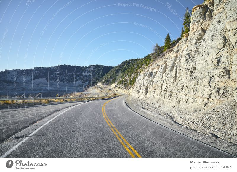 Scenic road, travel concept. trip summer Colorado mountains filtered highway marking lanes adventure journey road trip landscape nature USA wanderlust canyon