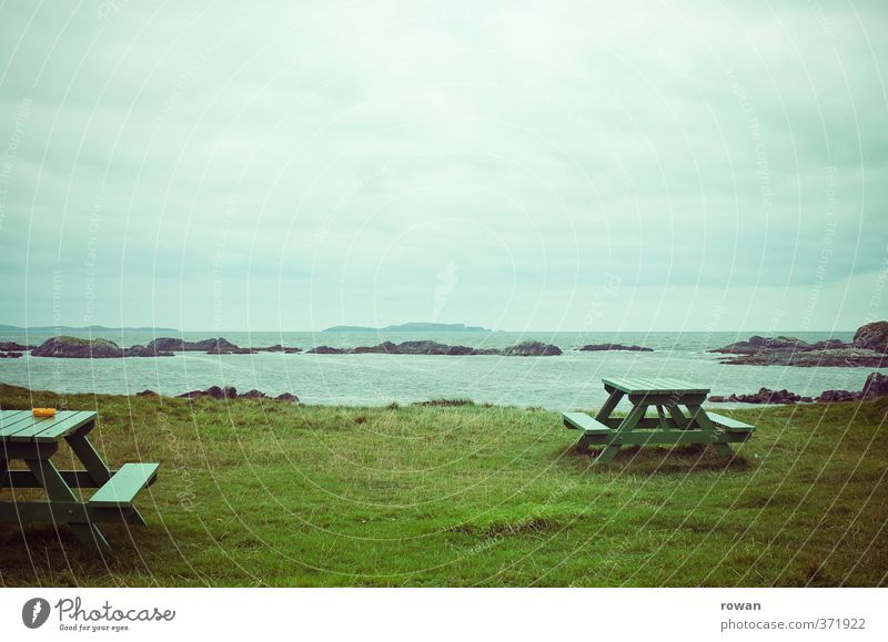 picnic Beautiful weather Grass Break Ocean Beach Coast Picnic Table Vantage point Ireland Green Relaxation Empty Loneliness Cold Gloomy Ashtray Clouds