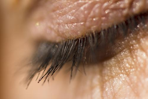 Macro shot of the human eyelid and eyelashes in. Daylight closeup closed skin person female adult beauty clean healthy macro conceptual cosmetic cry depression
