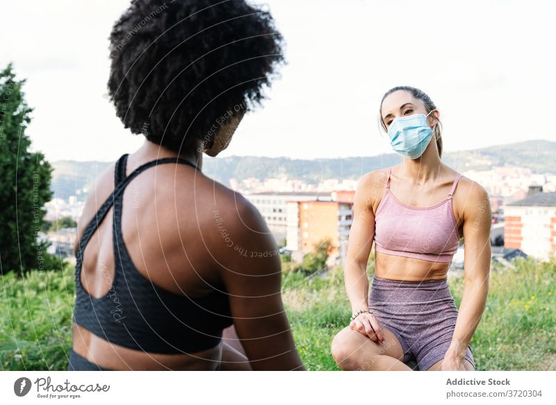 Young sportswomen in protective masks resting during workout fitness training sporty exercise coronavirus young multiracial multiethnic diverse african american