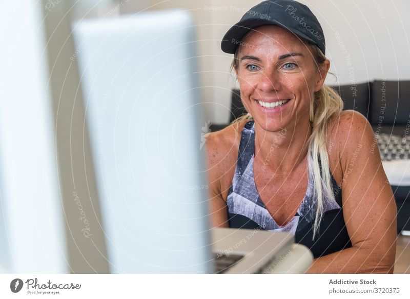 Sportswoman watching online tutorial at home workout training prepare sportswoman using laptop female athlete sportswear video internet fit fitness connection