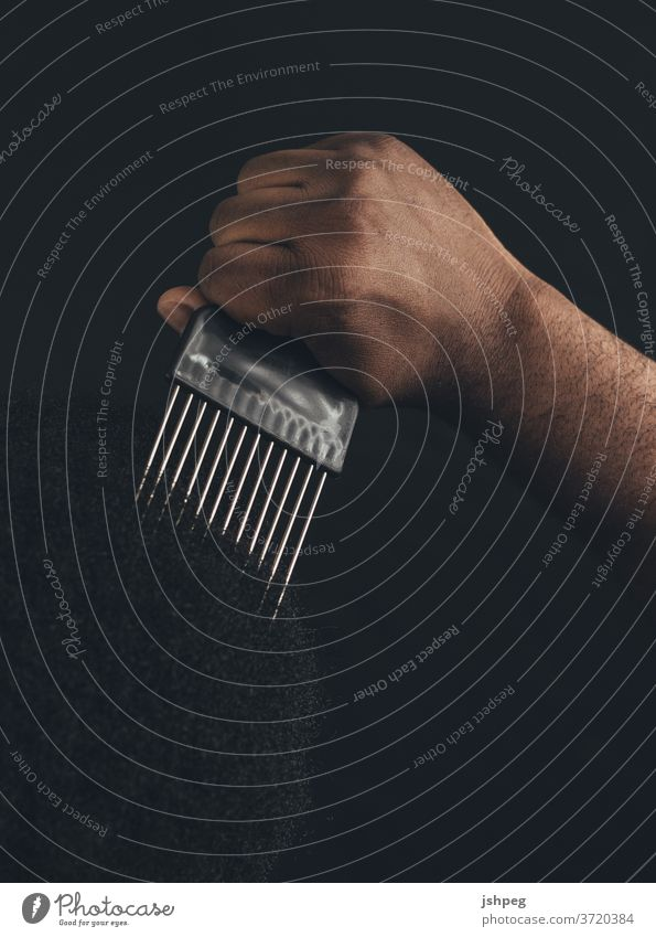 Black Man using Comb Pick pick comb blm Black Lives Matter Using Comb hair care Hair and hairstyles Black Hair hair dress hair dresser Adults Black Adult