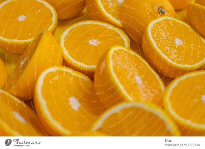 Halved oranges, which are immediately pressed into delicious fresh orange juice Orange juice juicy oranges Fresh halved Halves cute Juice Fruity salubriously