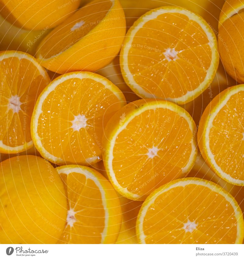 Halved oranges, which are immediately pressed into delicious fresh orange juice Orange juice juicy oranges Fresh halved Halves Sweet Juice Fruity salubriously