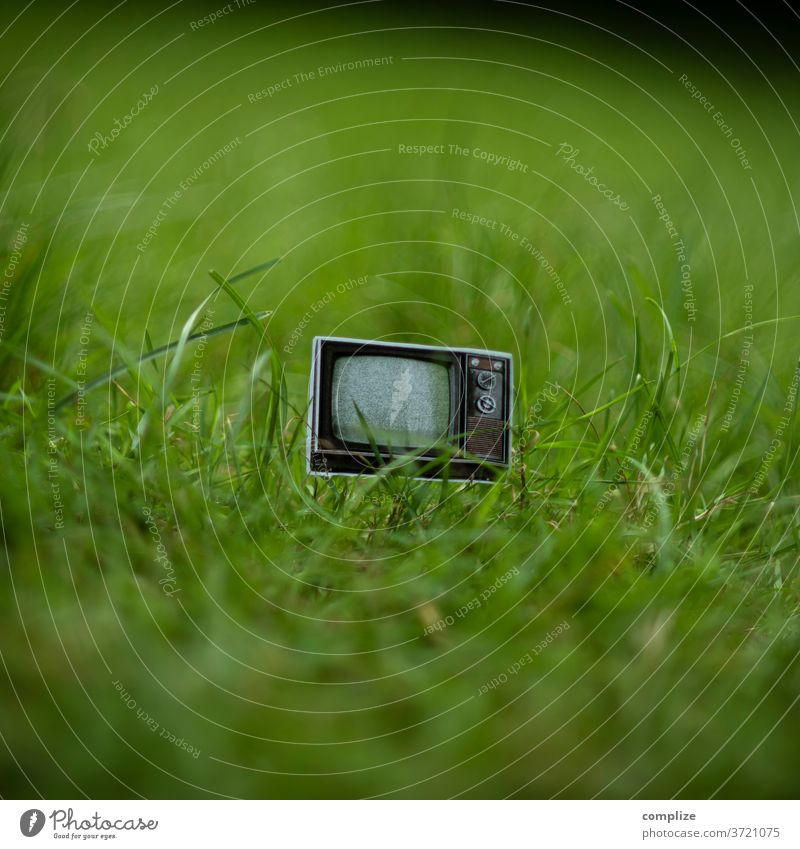 imgrünen.tv TV set vintage Bulk rubbish Trash waste Broken 70s 80s chuck away Old Television, television screen technology Program Grass green Meadow Garden cut