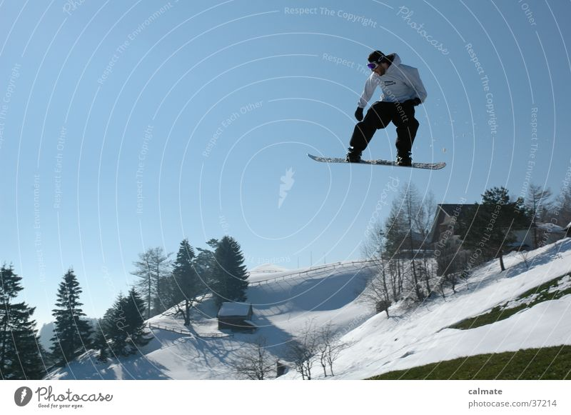 Snow Style Flying Jump Tall Beautiful weather Hill Brave Downward Snowscape Blue sky Snowboard Freestyle Talented Snowboarding Extreme sports