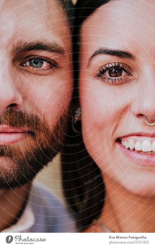close up view of young happy couple together. Eyes close up. Love and family concept eyes portrait half 2 adult beautiful boyfriend caucasian city date dating
