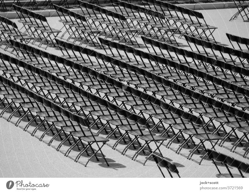 row after row of folding chairs Folding chair Row of seats Orderliness Equal Structures and shapes Symmetry Many Free Accuracy Seating Seating capacity