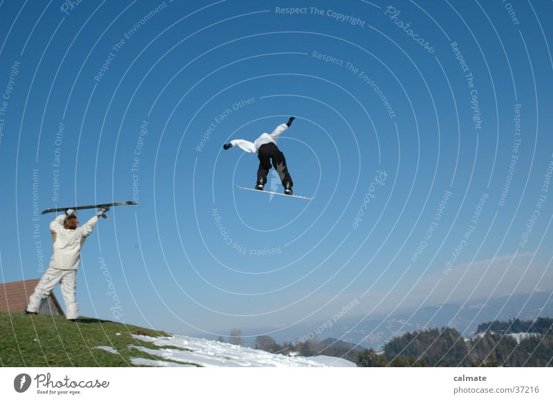 Snowboard St.Anton (CH) Jump Extreme sports Tall far Crazy Snowboarder Snowboarding 2 Audience Blue sky Snow melt Climate change Hill Meadow Whimsical Flying