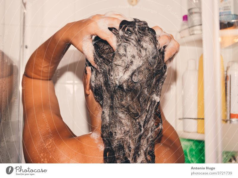 Woman washing her hair in the shower. woman shampoo bodycare hygiene one person purity caucasian brunette cleansing foam naked relaxation wellness wet